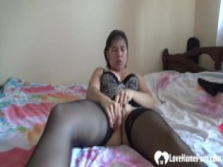 milf wearing black stockings masturbates with a big dildo